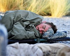 Royal Marine Asleep Betwen Operations in Southern Afghanistan by Defence Images, via Flickr