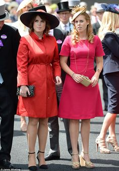 Princess Eugenie and Princess Beatrice take in the atmosphere in the parade ring before racing
