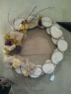 Wreath made from slices of wood. Really like this idea.