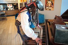 This pirate has many talents but playing the piano isn't one of them!