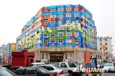 Colourful murals in Qingdao, China; covering more than 60,000 square metres on 21 buildings at a shopping street in Qingdao's Taidong commercial district. The painting was completed in June 2008 in conjunction with the Beijing Olympics.