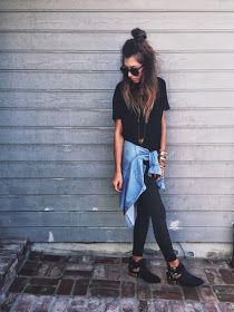 black top, black pants, collared shirt, moto boots, sunglasses, long necklace, beach hair