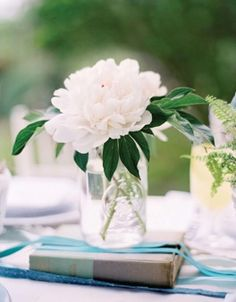 Law School Graduation. Try using books and a simple floral arrangement for your table centerpieces.