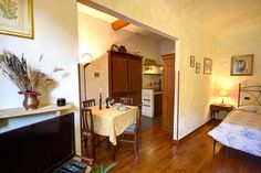 Florence, Italy Vacation Rental, 1 bed, 1 bath with WIFI. Thousands of photos and unbiased customer reviews, Enjoy a great Florence apartment rental perfect for your next holiday. Book online! Florence Apartment, Next Holiday, Italy Vacation, Florence Italy, Rental Apartments, Wifi, Bath, Table, Photos