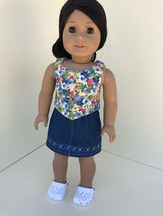 American Girl Doll Sleeveless Angled Crop Top - Yellow & Blue Floral (skirt sold separately) (shoes not included) Crop Top Fits Our Generation Doll as well. Easy-to-Dress = Velcro Back Closure on dress so that doll is easy to dress for small inexperienced hands. Easy-to-Wash = Made