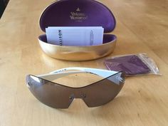 1b9c444b5a8 Vivienne Westwood VW59703 Rimless Ladies Sunglasses in White Grey. Sunglasses  AccessoriesSunglasses WomenGrey OutfitOptical FramesVivienne WestwoodFashion  ...