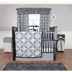 The Medallions 5-piece Crib Bedding Set by Trend Lab features spectacular filigree medallions, variegated stripes and mini starbursts printed on cozy fabric. The classic color palette of black and whi