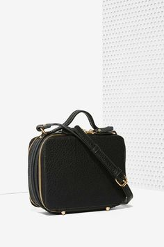 Gone are the days of digging for you phone when you've got the Sydney Crossbody Bag