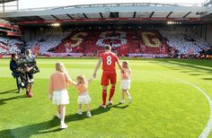 Steven Gerrard of Liverpool brings his daughters onto the pitch before the match
