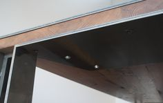 Traditionally joined wood table with metal post legs.
