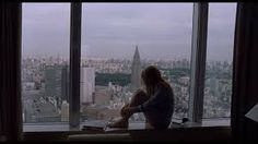 Image result for woman looks through window city