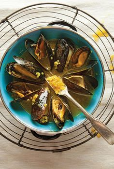 Curried Mussels | Curry powder and cilantro add zest to classic white wine-steamed mussels.