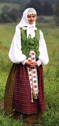 Europe | Portrait of a woman wearing traditional clothes, Lithuania