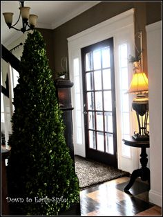 Homeowner added extra molding around the builder-grade front door to make it look more like old doors with character