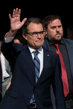 President of Catalonia Artur Mas (L) waves as he leaves the Palau de la Generalitat, the Catalan government building, next to the Leader of the Pro-Independence political party Esquerra Republicana de Catalunya (ERC) Oriol Junqueras on September 27, 2014 in Barcelona, Catalonia. President of Catalonia Artur Mas has signed the decree to call for a self-determination referendum from Spain on November 9.