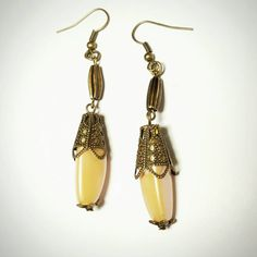 Moroccan & European Style 2 Tier Drop Earrings Only $5.89! - SALE Victorian Pearlized Creme Peach 3 Sided Barrel Bead Drop Earrings w/Moroccan Bronze Cones & Vintage Curved Ribbed Barrels FREE SHIPPING https://www.etsy.com/listing/263602297/sale-victorian-pearlized-creme-peach-3