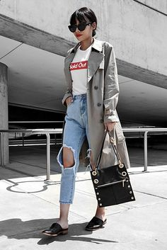 spring outfit, fall outfit, casual outfit, trench coat outfit - khaki trench coat, graphic t-shirt, distressed crop jeans, black flat mules, black shoulder bag, black cat eye sunglasses