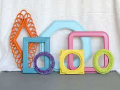 Bright Painted Funky Frames Set of 7 Lime Green Orange Aqua Pink Purple Yellow- Upcycled frames Gallery Wall Playroom Teen Girl Kids room. $54.00, via Etsy.