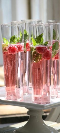 Beautiful cocktails of champagne, cranberry, and raspberry.