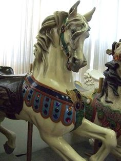 Carousel animals produced by Charles ID Loof in the late 19th century by Mary Harrsch, via Flickr.