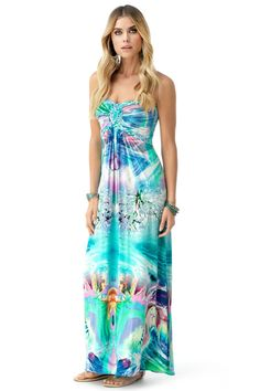 Get ready for that sunset party in this floral print maxi dress.  Braids gather around the bust to highlight your curves.   95% Rayon  5% Spandex    Made in the USA    Model is wearing XS