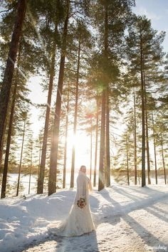 An Australian bride and a Finnish groom decided to have an open air chapel Winter Wedding in Finland. First look photos, fun games and lots of snow!