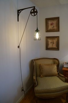 Similar to our bedside lighting, but with wooden brackets & cloth covered cord.