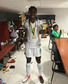 All I do is win no matter what!- says Asisat Oshoala as she displays AWCON & highest goal scorer trophies