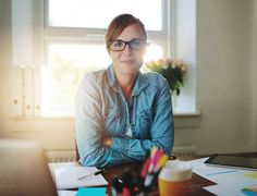 Successful business woman at office by Stefan & Janni on Creative Market