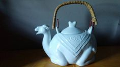 White ceramic camel teapot 1980 Pier One Imports Hey, I found this really awesome Etsy listing at https://www.etsy.com/listing/242116444/1980-pier-one-white-ceramic-camel-teapot