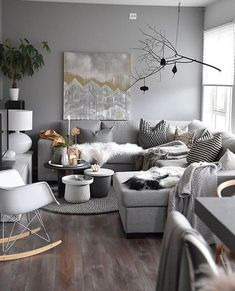Bright Scandinavian living room with grey interior.