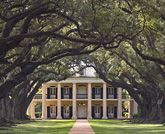 "Located on the Mississippi River between the historic Louisiana cities of New Orleans and Baton Rouge, Oak Alley Plantation has been called the ""Grande Dame of the Great River Road""."