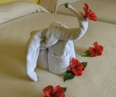 An adorable looking elephant towel origami. It's a cute towel design that you can use for the bedroom with subtle accents for the eyes and trunk. Make your own cute and adorable Creative Towel Origami Have you ever walked into… Continue Reading → Origami Design, Origami Towel Folding, Origami Boot, Elephant Towel, Little Girl Crafts, Hotel Towels, Bathroom Towel Decor, Baby Elefant, Towel Animals