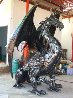 You don't HAVE to have a 2 metre high dragon. They do sculptures as small as high - or you can commission your own. Sculpture Metal, Dragons, Steel Art, Welding Art, Welding Projects, Arte Horror, Arte Popular, Dragon Art, Dragon Statue