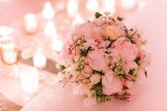 The softest of pink peonies with touches of foliage for this dreamy bridal bouquet