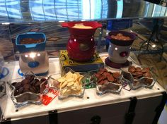 Velata  Scentsy now has special FONDUE warmers for CHOCOLATE, owned by Scentsy but the company is called Velata...its good too! So NO FLAME to heat the chocolate, it's all ELECTRIC! Dip pretzles, strawberries, anything your taste buds desire!  http://www.lindasfundue.velata.us/