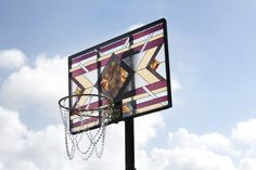Literally Balling Using gems and glasswork, artist Victor Solomon has created a of basketball hoops that takes fine art to the court. Each hoop features a different stained glass backboard and gold chain netting.