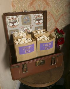 Throw a chic Grand Budapest Hotel themed party to celebrate the Oscar's with Lobby boy bags of popcorn!