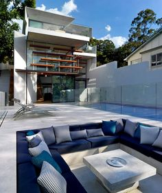 This beautifully designed modern home in Mosman, Sydney, Australia by Rolf Ockert; is an exciting piece of architecture yet at the same time feels like a family home. Modern Architecture House, Modern House Design, Interior Architecture, Interior Design, Interior Decorating, House Built Into Hillside, Outdoor Spaces, Outdoor Living, Moderne Pools