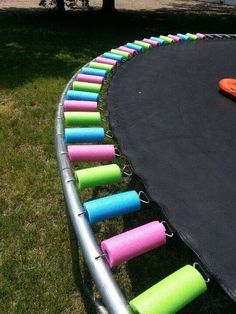 Our trampoline padding/cover has really taken a hit with the wind and rain this past Spring and Summer. I started searching for a replacement pad and was $hocked at how  X$pen$ive they were. I found this and am so excited!!!! It looks cute, covers the springs, and should hold up rather well. I estimate it costing roughly $25 for Pool noodles. As soon as anyone notices Dollar Tree having them in stock leg me know :)