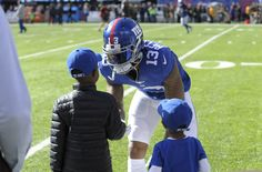 That moment when you get to meet your hero. OBJ giving back to the fans in Week 9. (AP/Kostroun)