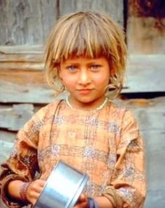 Nuristani child  Afghanistan. The Nuristani people's closest relation is to the Kalash people. Furthermore, they have very little genetic relation to neighboring ethnic groups like Pashtuns and Kashmiris. This is because they have always remained isolated in the mountains which has led them to become a genetically isolated population. It is also speculated that Nuristani people are of different origin altogether assimilated in the region at some point of time in history.