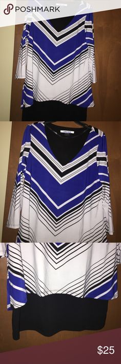"Nygard Knit Top layered Worn once. Looks brand new. Black white and blue colors. 3/4 sleeve. Knit multi top over faux black camisole. 94% Polyester 6% Spandex. Back neck Sean to hem 29"" Nygard Tops"