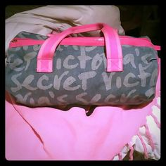 *Free Gift* with any VS order of 20$ or more! Adorable VS PINK gym duffle bag. Blue with Victoria's Secret written throughout bag. Pink straps and zipper lining. Zipper clasp is broken but is able to still be zipped up. Described in 4th photo. In lovingly used condition. Will sell for 15$ for anyone who wants to the opportunity to just purchase duffle gym bag alone. Price Firm. Victoria's Secret Bags Travel Bags
