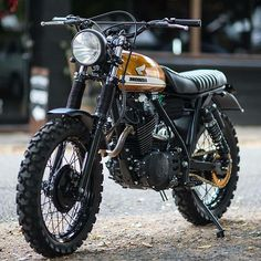 As the world's largest producer of motorcycles, it comes as no surprise that Honda cafe racers are commonplace. Here are our Top 10 Honda Cafe Racer picks. Cafe Racer Honda, Honda Scrambler, Gs 500 Cafe Racer, Scrambler Cafe Racer, Cafe Bike, Cafe Racer Bikes, Cafe Racer Motorcycle, Honda Motorcycles, Yamaha Tw200