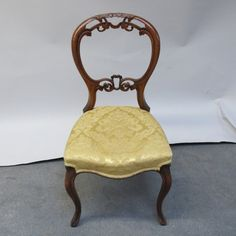 Lot no: 111. A set of four Victorian mahogany carved balloon back dining chairs with gold upholstered seats