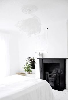 My Bedroom: white by Agatha Kruk. Love the black period fireplace in this white space.