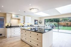 white kitchen in esher surrey  extension built by l u0026e  lofts and extensions  kitchen with pink backsplash design ideas remodel from a1 kitchen      rh   pinterest co uk