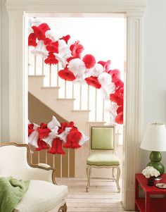 Make the Banister Festive  Banisters can be tricky to decorate. For a light, airy, and cheerful look, try stringing red and white paper bells together with fishing line.