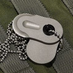 Triple Aught Design Titanium Dog Tag Knife Cuz these TOTALLY resemble dog tags. There is a company that makes less expensive ones, low profile.. I will find, & post...